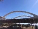 Biking Over Bridge Arches