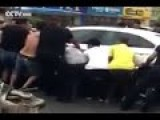 Heroic Crowd Lifts Car To Save Elderly Man Trapped Underneath