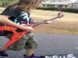 Skateboarder Shreds Guitar While Riding Skateboards