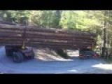Logging Truck Passing A Hairpin Bend On Mountain Road