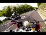 2 Guys Race Motorcycles On A Road