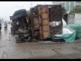 Repairmen Lucky To Escape Truck Rollover In China