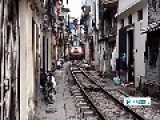 Train Travels Through Narrow Gap In-between Houses In Vietnam