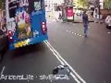 Stupid Guy Almost Gets Run Over After Running Out Behind Bus