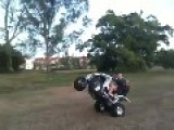 Two Girls Slide Off ATV During Wheelie