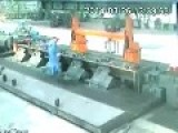 Worker Escapes Being Clamped By Closing Arm