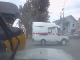 An Ambulance Crashes Into Taxi At Intersection