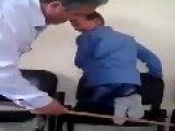 Sick Teacher Beating His Students By A Stick In Their Feets