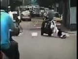 Husband Doesn't Notice Wife Being Dragged On Ground Behind Scooter