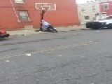 Bully Philly Police Officer Knocks Over Basketball Goal