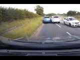 Reckless Porsche Driver Over Takes Car Dangerously Close