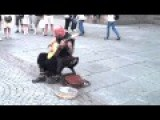 Tattooed Street Performer In Strasbourg, France, Has Amazing Vocal Talent
