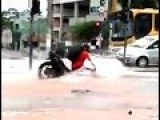 Biker Falls Into Sinkhole In The Middle Of The Road!