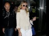 Gwyneth Paltrow Wears Cream Sweater While Walking Through JFK