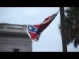 Activist Ignores Police And Takes Down Confederate Flag