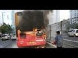 A Man Alone Extinguish A Burning Bus
