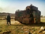 A Citizen Soldier Poses Next To A Bizarre Armoured Contraption, Captured From Kurdish Terrorists