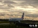Airplane Lands In Rain Causing Huge Spray Of Water