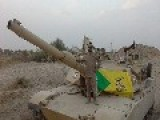 An Image Of A 'kata'ib Hezbollah In Iraq Brigade' Member Proudly Posing On His Abrams Tank