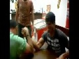 Arm Wrestling Mishap