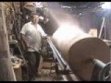 A Woodworker Dangerously Turning A Huge Log On A Wood Lathe
