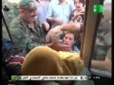 A Bus Load Of Captured Terrorists Get Harrased By Civillians