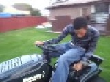 African Guy On Lawn Mower Backwards