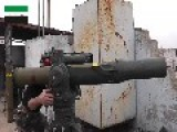 A Syrian Sunni Arab Citizen Tank Hunter Gets A Hit On A Moving Assad Crime Dynasty T-62, With A TOW ATGM: