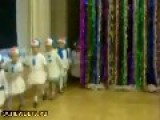 A Child Dressed As Snowmen Dancing On New Year's Party