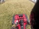 ATV Wheelies On A Farm By Itself