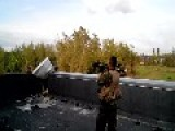 A Russian Terrorist Enjoys Himself By Firing An Anti-armour Rocket At Donetsk Airport's Terminal One