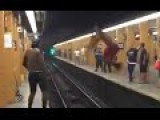 A Guy Jumps Over The Rails Of A Subway