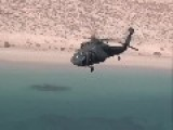 Aerial Footage Of Black Hawk Helicopters Flying Over Kuwaiti Desert And Arabian Gulf