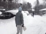 Asian Guy Uses Dustpan To Clean Up After A Blizzard