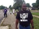 An Image Of A Citizen Of Ferguson Wearing A Pro IS T-shirt