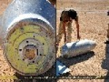 An Image Of A Syrian Citizen Rather Recklessly Stood Next To An Unexploded Imperial US Navy Tomahawk Missile Warhead: Palmyra