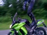Biker Stands And Rides On Motorcycle