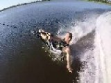 Barefoot Skier Falls Holding Onto Rope With Foot