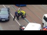 Black Policeman Beating The Pole. Netherlands