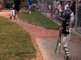 Boy Plays Catcher Position In Baseball With One Leg
