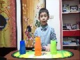 Boy Stacks Glowing Plastic Cups Incredibly Fast