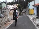 Brazilian Biker Goes Down Favela Streets On Front Wheels!