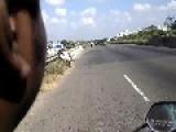 Biker Rides Side Saddle On Highway