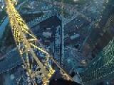 Brave Soul Balances On Crane High Above City