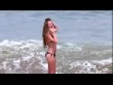 Bikini Girl Gets Taken Out By Wave