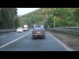BMW With Lambo Doors Overtaking On A Curve