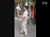 Chinese Father Swings His Baby Around