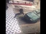 CCTV-Funny Girl Falls Down Trying To Take Spot Of Car