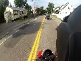 Car Nearly Hits Motorcycle On Residential Street