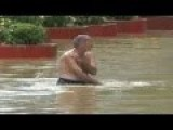 Crazy Man Swimming, Diving And At The End Falling In Flooded Street
